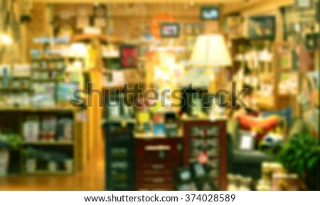 De focused/ Blurred image of a stationery store. Green tone. - stock photo