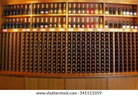 De focused/ Blurred image of bottles of wine in liquor cabinet - stock photo