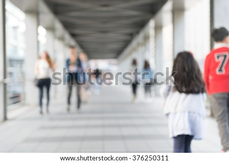 De focused/Blurred image of Subway train leaving station. People coming to or leaving the platform. - stock photo