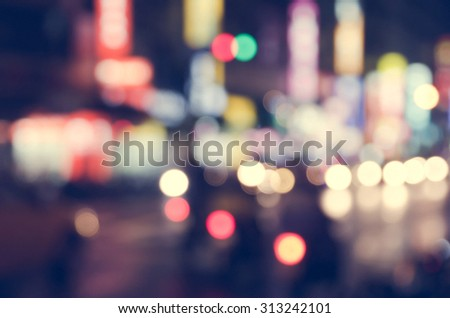 De focused/Blurred image of traffic lights. Blur lights. Light bokeh. Retro effect. - stock photo