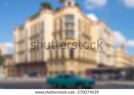 De-focused building and car - stock photo