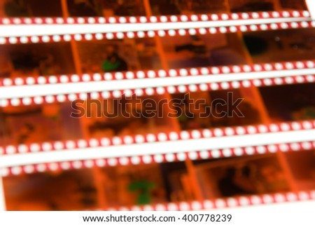 De-focused 35 mm color negative photo camera films horizontal background on white - stock photo
