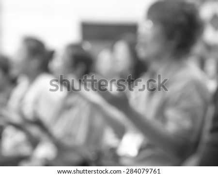 De focused or blurred people raising hand to worship in religion ceremony - stock photo