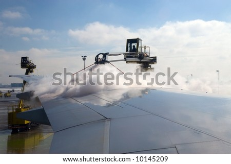 De-ice airplane during winter before takeoff. - stock photo