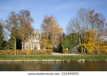 De Meern, The Netherlands, 21 november 2014: old farm between De Meern and Harmelen in The Netherlands and autumn colors - stock photo