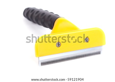 De-shedding tool. Isolated on a white background. - stock photo