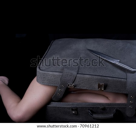 Dead blonde body in suitcase