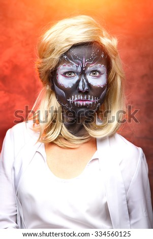 Dead bride woman in skull face dark mask. Halloween. Woman skeleton on a red black background. Halloween, make up skull. Magic sorceress - concept. Fantasy woman. Witch, zombie, skeleton. - stock photo