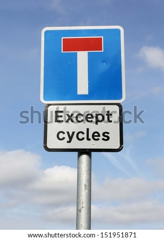 Dead end no through road traffic sign except for cyclists, isolated roadside T concept signage on pole post signpost signboard, blue red  - stock photo
