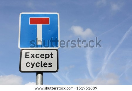Dead end no through road traffic sign except for cyclists, isolated roadside T concept signage on pole post signpost signboard, blue red