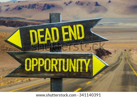 Dead End - Opportunity signpost in a desert road background - stock photo