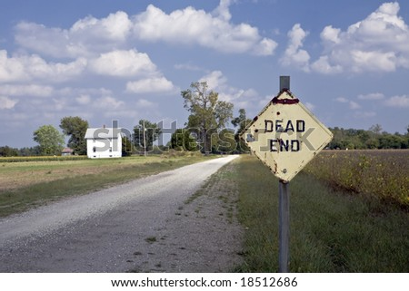 Dead End sign guards a lonely gravel road in rural Kansas
