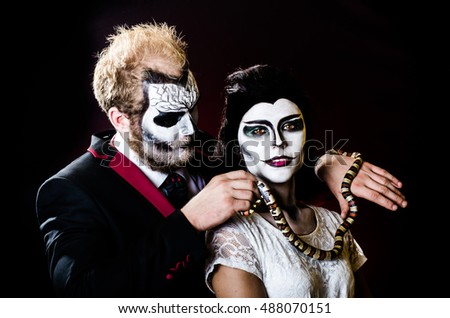 Dead face boy and girl with beautiful snake