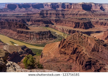 Dead Horse Point State Park in Utah, USA, overlooks the Colorado 2000 feet below with its carved canyon and amazing geologic formations. - stock photo