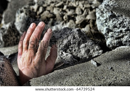 Dead man hand sticking out of destroyed concrete rubble debris after a catastrophic disaster earthquake (fictitious staged photograph) - stock photo