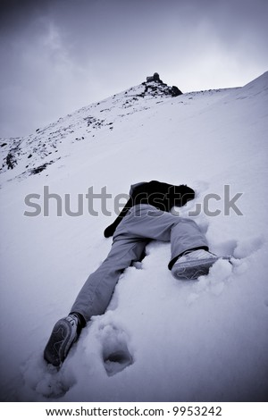 Dead man over white snow. Blue toned with vignetting. - stock photo