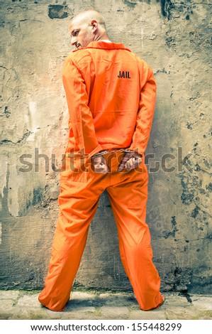 Dead Man Walking - Prisoner with Handcuffs standing proud - stock photo