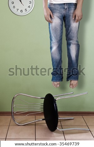 dead men and falling down chair - stock photo