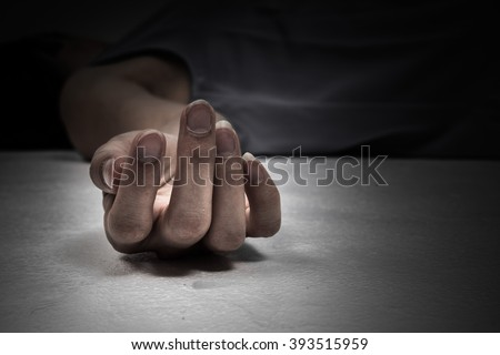 Dead person. Focus at the Hand - stock photo