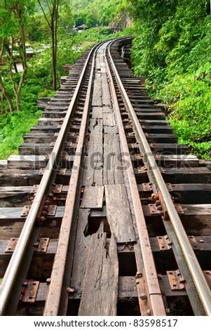 Dead railway beside cliff in Thailand - stock photo