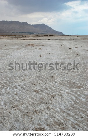 Dead Sea coastline with mountains at nasty day