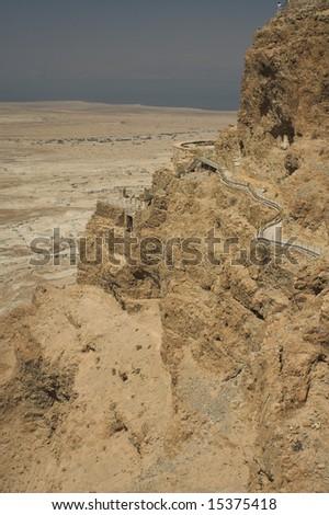 Dead sea view of ancient city Masada - stock photo