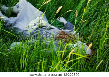 Dead Woman Laying in Grass - stock photo