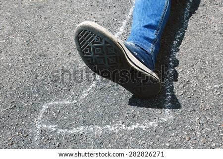 Dead woman laying on asphalt - stock photo