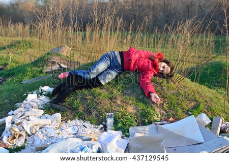 Dead woman lying on landfill - stock photo