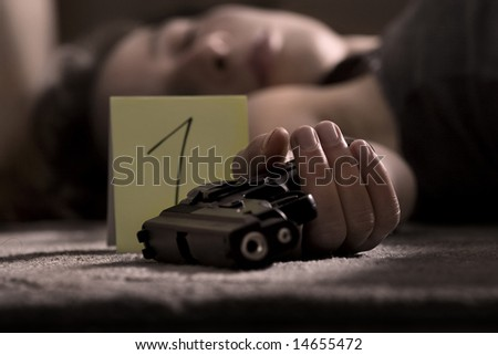 dead woman lying on the floor with gun in the hand - stock photo