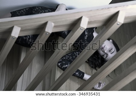 Dead woman lying on wooden stairs - stock photo