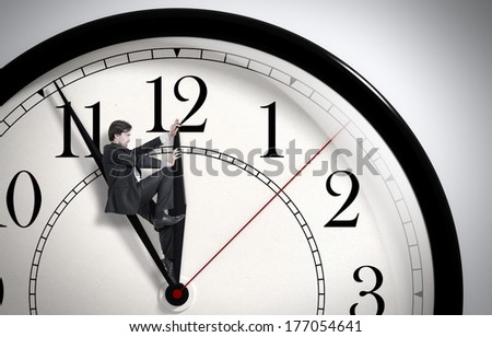 Deadline. Businessman trying to stop time. Time Management. Time pressure. Cure for old age. Annual reports. Front view. - stock photo