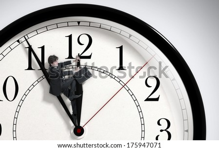 Deadline. Businessman trying to stop time. Time Management. Time pressure. Cure for old age. Front view. - stock photo