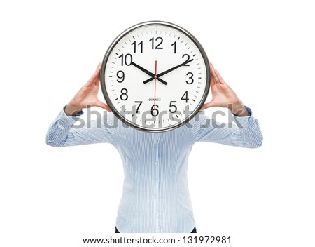 Deadline concept, close up of young businesswoman covering her face with analog clock isolated on white background - stock photo