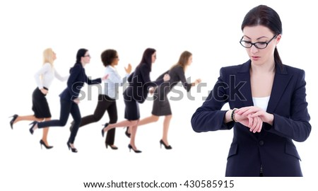 deadline concept - young business woman checks time on wrist watch and her running colleagues isolated on white background - stock photo