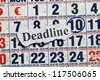 Deadline cutout in a calendar with date encircle. - stock photo