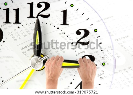 Deadline. hand trying to stop time. Time Management. Time pressure. Business concept. Cure for old age. Annual reports. Front view. - stock photo