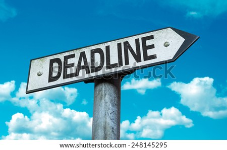 Deadline sign with sky background - stock photo