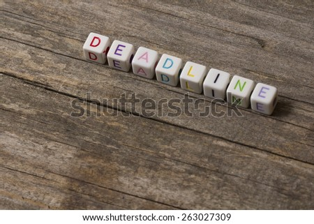 DEADLINE word on a wooden background - stock photo