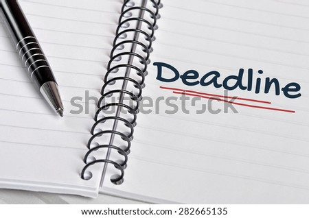 Deadline word on notebook page