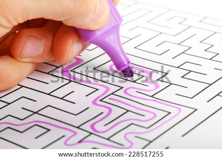 deadlock concept - trying to find way out of maze - stock photo