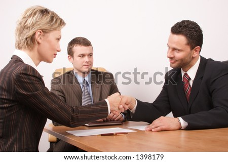 deal - Group of  3 business people - man and woman hand shake