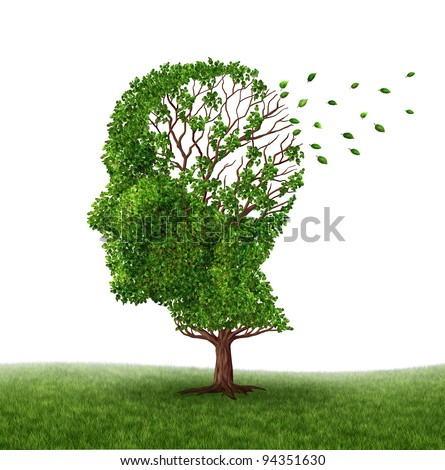 Dealing With Dementia and Alzheimer's disease as a medical icon of a tree in the shape of a human head and brain losing leaves as challenges in intelligence and memory loss due to injury or old age. - stock photo