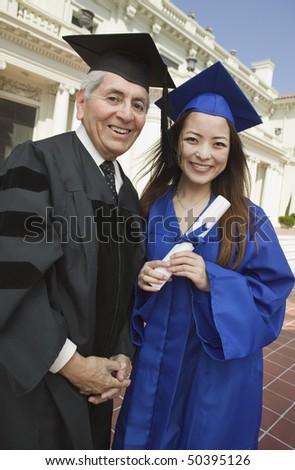 Dean and graduate outside university, portrait - stock photo