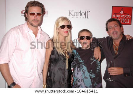 Dean McDermott and Tori Spelling with Jack McDermott and Rob Mione  at the Grand Opening of 'A Hollywood Spectacular'. A Hollywood Spectacular, West Hollywood, CA. 08-12-09 - stock photo
