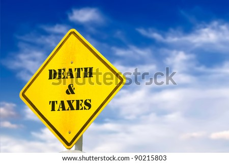 death and taxes road sign - stock photo