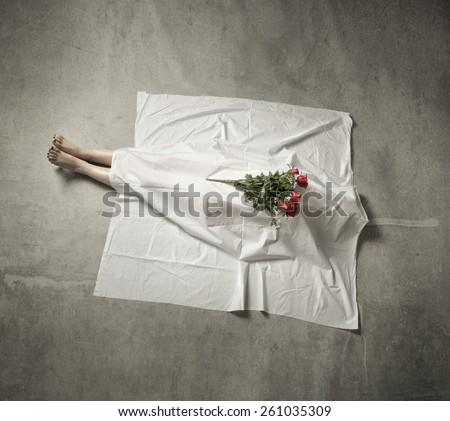 death body under white cloth - stock photo
