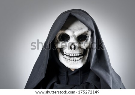 Death costume portrait on gray background