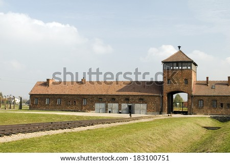 Death Gate entrance building Nazi Germany concentration camp Auschwitz-Birkenau extermination camp - stock photo