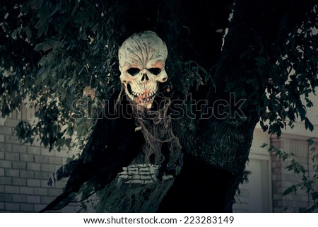 Death in a black hood and other scary Halloween decorations - stock photo